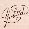 yuletide in fancy calligraphy against a plain manila background