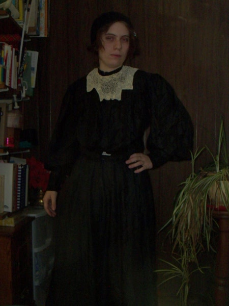 Me, in a grainy shot, wearing the black dress with a white lace collar