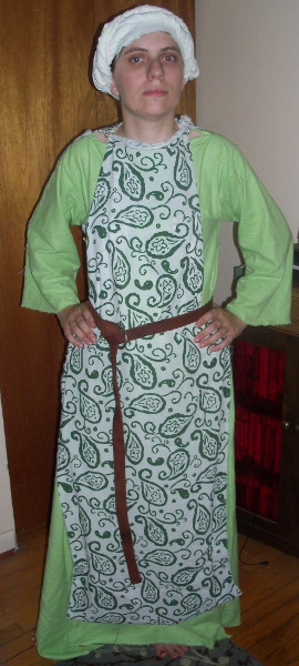 Me in a light green long, full tunic with a simple green-patterned overdress.